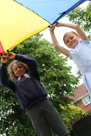 Barnton - 2 pupils playing with a large kite