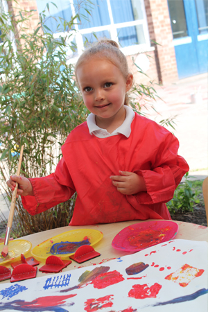 Barnton - A young pupil painting outside
